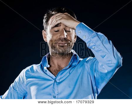caucasian man distraught unshaven portrait isolated studio on black background