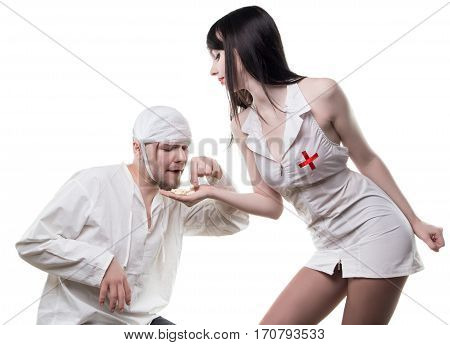 Sexual nurse offers anesthetic drugs on white background