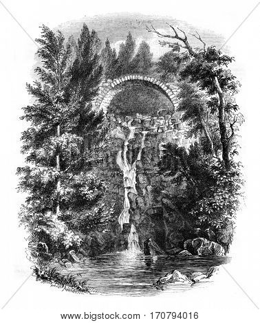 Cascade de la Roche, near the Puy, department of Haute Loire, vintage engraved illustration. Magasin Pittoresque 1846.