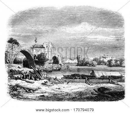 Ruins of Saint Benezet bridge, in Avignon, vintage engraved illustration. Magasin Pittoresque 1846.