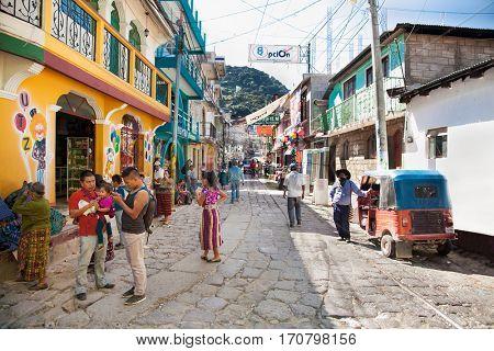 SAN PEDRO, GUATEMALA-DEC 24, 2015: Local people at main street  in San Pedro on Dec 24, 2015, Guatemala.