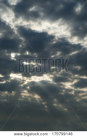 Stormy Dark Sky With Sun Rays Breaking Through