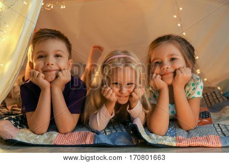 Cute little children in hovel at home