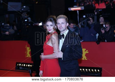 Stefanie Giesinger and her boyfriend Marcus Butler pose on the red carpet during opening ceremony of the 67th Berlinale Film Festival at Grand Hyatt Hotel in Berlin, Germany on February 9, 2017.