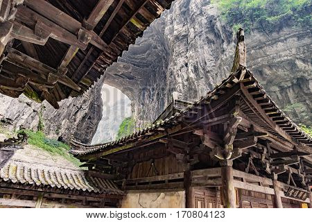 Roof top of Antique Chinese historical tavern in valley an important constituent part of the Wulong Karst World Natural Heritage Chongqing China
