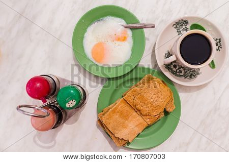 Traditional Singapore Breakfast Called Kaya Toast, Coffe Coconut Jam And Half-boiled Eggs