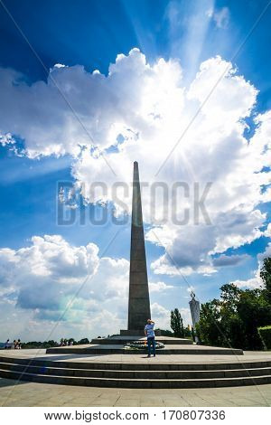 KIEV UKRAINE - JULY 31 2016: Man looking on Tomb of the Unknown Soldier in the Glory Square in Kiev
