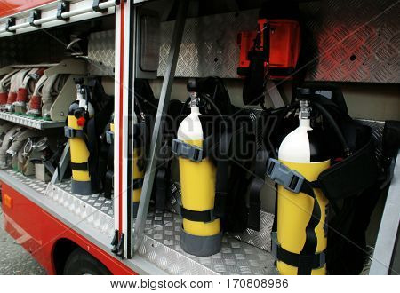 Oxygen cylinders in fire-fighting vehicle
