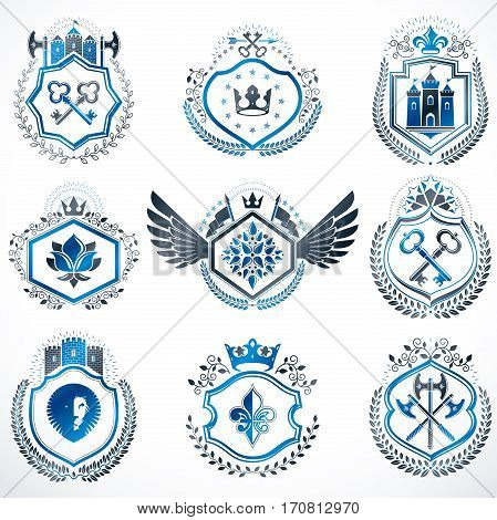 Heraldic decorative emblems made with royal crowns animal illustrations religious crosses armory and medieval castles. Collection of symbols in vintage style.