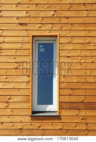 Plastic PVC Window in New Modern Passive Wooden House Facade Wall. PVC Windows are the Number One in Energy Efficiency.