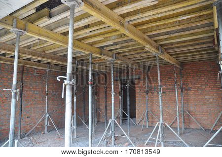 KYIV UKRAINE - February  14 2017: Ceiling and Wall Construction. Building a concrete ceiling with plywood boards