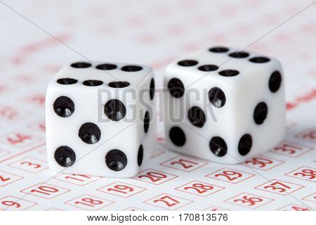 Close-up of dices on lottery ticket concept for gambling