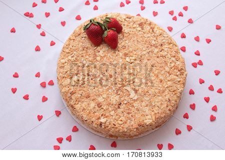 Cake Napoleon with strawberries isolated on a white background.