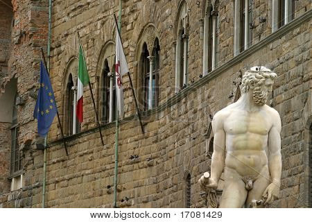 The European, Florentine and Italian flags fly over one of Florence's statues