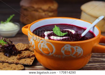 cream soup from beet with sour cream and fresh herbs