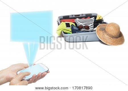 Female hands holding a smart phone radiating a transparent rectangle. Suitcase packed with clothes is in the background. Everything is on a white background. All potential trademarks are removed.