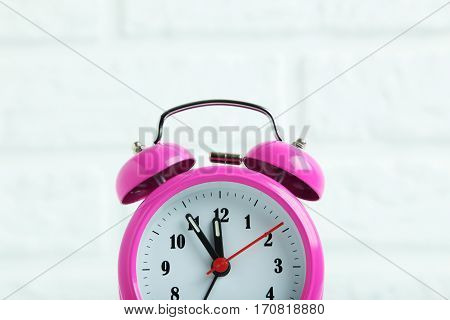 Pink Alarm Clock On The Brick Wall Background
