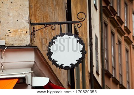 old forge iron sign with empty space in Stockholm city