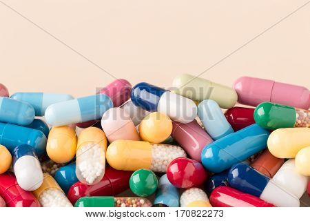 Colorful pills with copy space on bright background