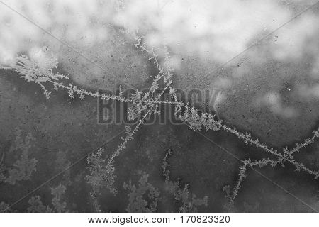 Belarus-October 13 2016 Frosty drawing on window glass drawing with frost on the window black and white image ottaevshee glass windows beautiful pictures the artist frostyin and yang