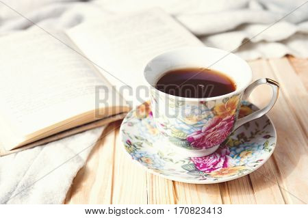 Cozy Home Still Life: Cup Of Hot Coffee Or Tea And Opened Book With Warm Plaid