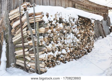 Firewood Snow. The stack of the snowy firewood