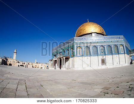 A fish-eye view of the gold-domed mosque built on the disputed Temple Mount in Jerusalem Israel.