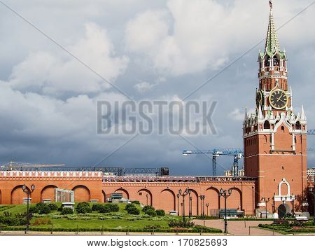 A part of the red wall and tower of the Kremlin in downtown Moscow Russia on a cloudy day.