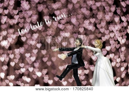 Running groom chased by bride (Concept of wedding)