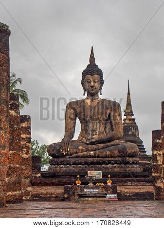 A statue of Bhudda at Sukhothai Historic Park in Thailand.