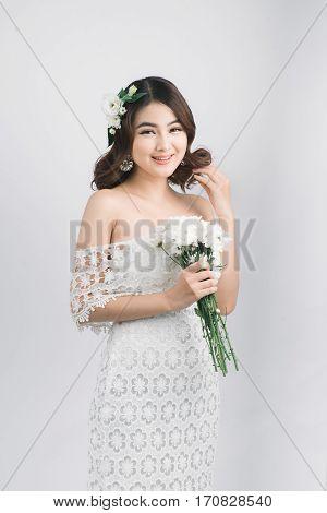 Beautiful asian woman bride on grey background.