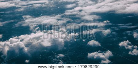 Beautiful cloudscape from a plane window over Greece