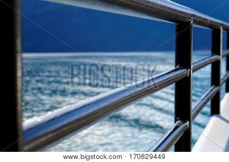 A close up of the railing on a ship