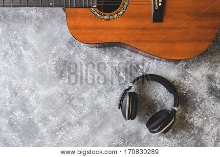 Top view of Guitar with headphone on grunge background
