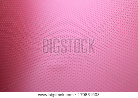 the texture of the paper sheet red-crimson color with volumetric texture points. Abstract soft focus. Background mode