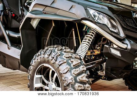 Sports ATV standing on the pavement, double sport quadrocycle, 4x4 wheels