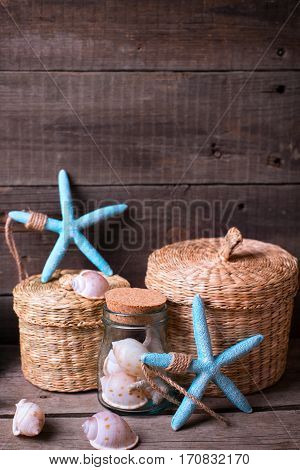 Coastal items on aged wooden background. Sea objects on wooden planks. Selective focus. Place for text. Vertical image.