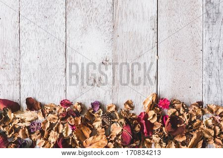 Top View Of  Dried Flowers On Wooden Table Background .free Space For Your Text