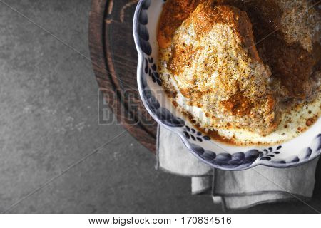 Butter chicken in a blue bowl on a napkin horizontal
