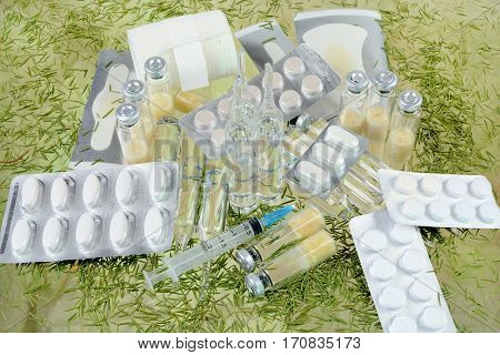 Drugs for the treatment of patients. Medicines on the glass with the needles of pine needles