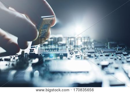 Electronic engineer of computer technology. Maintenance computer cpu hardware upgrade of motherboard component. Pc repair, technician and industry support concept.