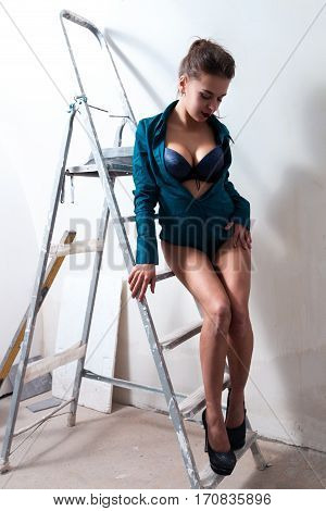 Sexy Girl In Erotic Outfit On A Stepladder, Make Room Repairs