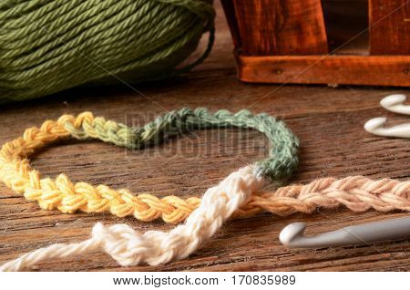 A low angle image of crochet yarn and crochet hooks.