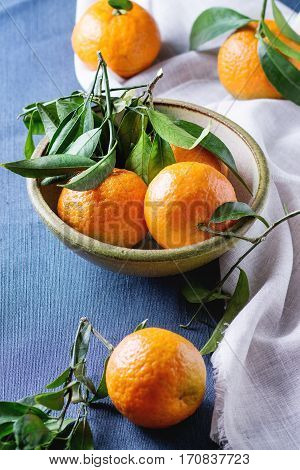 Bowl Of Tangerines With Leaves