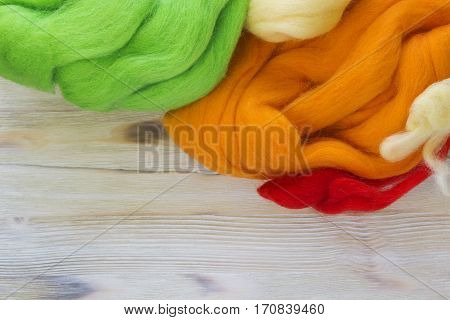 Dry merino bright colorful wool for felting. Green orange white and yellow dried yarn for the creative craft fashion work