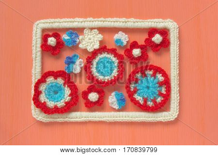 Marine background with cotton lace crochet craft elements: stars shells flowers and frame made of soft acrylic wool yarn. Crocheted creative doilies. Decorative needlework marine design soft focus