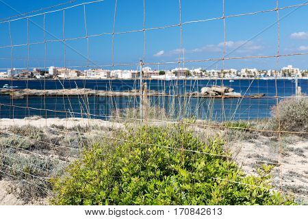 Sea view and beach through the fence Mallorca Spain