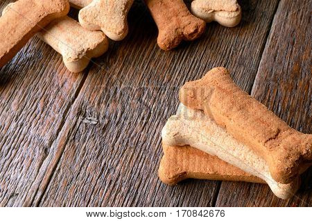 A low angle image of several healthy bone shaped dog treats.