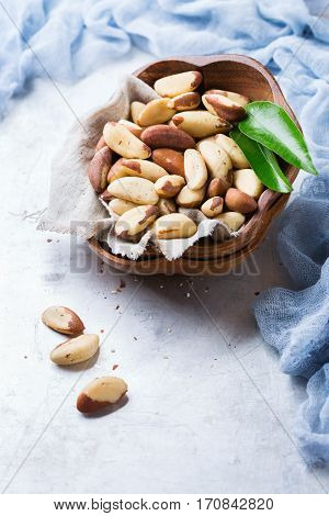 Still life, food and drink, heathy nutrition concept. Portion of organic healthy brazil nuts on a rustic table, selenium source. Copy space background