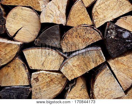 Background Of Chopped Firewood Logs In A Pile